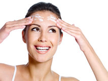 Woman with cream on the forehead looking up Royalty Free Stock Photos