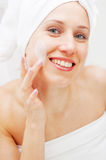Woman with cream on her face Royalty Free Stock Photo