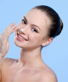 Woman with cream on her nose Stock Photos