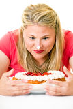 Woman with cream on nose staring at cake Royalty Free Stock Images