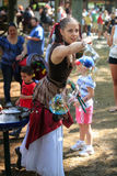 Woman Creates Bubble Art Renaissance Festival MD. Beautiful young woman in medieval costume creates art by making soap bubbles to entertain patrons from all over Royalty Free Stock Photos