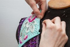 A woman creates exclusive clothes. Royalty Free Stock Photography