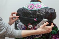 A woman creates exclusive clothes. Stock Photo