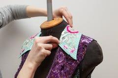 A woman creates exclusive clothes. Royalty Free Stock Photos