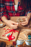 Woman creates a woolen heart. Royalty Free Stock Photos
