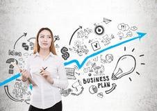 Woman creating business plan Stock Photo