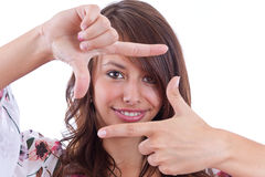 Woman creating a frame with her fingers Royalty Free Stock Photography