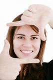 Woman creating a frame with her fingers Royalty Free Stock Photo