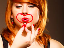 Woman creating heart symbol. Stock Photo