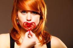 Woman creating heart symbol. Stock Photography