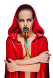 Woman with a creative bright make-up in red cloak Royalty Free Stock Photography