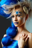 Woman with creative fantasy hairstyle. Beautiful fashionable young woman with creative fantasy hairstyle with blue hairs and art make up royalty free stock images