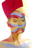 Woman with creative geometry make up, tree color red, yellow, blue Stock Photos