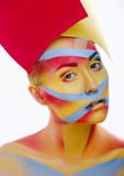 Woman with creative geometry make up, tree color red, yellow, blue Stock Image