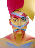 Woman with creative geometry make up, tree color red, yellow, blue Royalty Free Stock Images