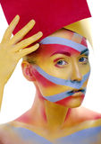 Woman with creative geometry make up, tree color red, yellow, blue Royalty Free Stock Image