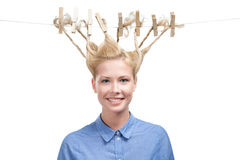 Woman with creative haircut of clothes pegs Stock Images