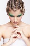 Woman with creative hairdo Stock Photo