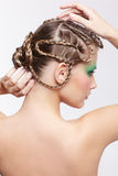 Woman with creative hairdo Stock Photo