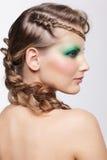 Woman with creative hairdo Stock Photography