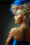 Woman with creative hairstyle. Beautiful fashionable young women with creative hairstyle with blue hairs and art make up stock photography