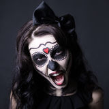 Woman with creative Halloween skull make up screaming over black Royalty Free Stock Photo