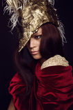 Woman in creative head wear with feathers Stock Images