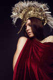 Woman in creative head wear with feathers Stock Image