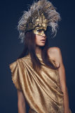 Woman in creative head wear with feathers Stock Photo