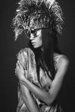 Woman in creative head wear with feathers Royalty Free Stock Images