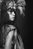 Woman in creative head wear with feathers Royalty Free Stock Photography