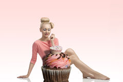 Woman with creative look and cupcake Stock Photo