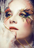 Woman with creative make up closeup like butterfly, summer trend big lashes Stock Images