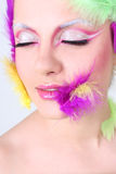Woman with creative make-up and feathers Stock Photography