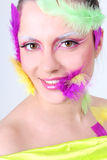 Woman with creative make-up and feathers Stock Photos