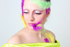 Woman with creative make-up and feathers Royalty Free Stock Photo