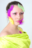 Woman with creative make-up and feathers Royalty Free Stock Photography