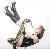 Woman with creative make up holding Python Royalty Free Stock Photography