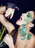 Woman with creative make up like snake with rat in her hands Royalty Free Stock Photo