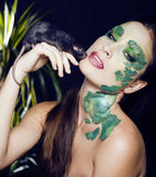 Woman with creative make up like snake with rat in her hands Royalty Free Stock Image
