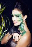 Woman with creative make up like snake and rat in her hands, hal Royalty Free Stock Photography