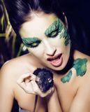 Woman with creative make up like snake and rat in her hands, hal. Loween horror closeup joke scary, crazy wild concept Royalty Free Stock Photography
