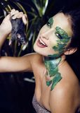 Woman with creative make up like snake and rat in Royalty Free Stock Images