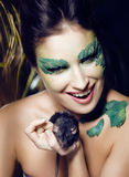 Woman with creative make up like snake and rat in her hands, halloween horror closeup Stock Photos