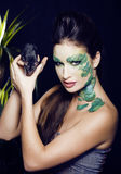 Woman with creative make up like snake and rat in her hands, halloween horror closeup joke scary Royalty Free Stock Photography