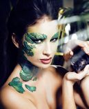 Woman with creative make up like snake and rat in her hands, hal. Loween horror closeup joke scary, crazy wild concept close up Royalty Free Stock Images