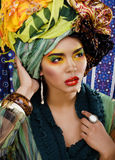 Woman with creative make up, many shawls on head like cubian woman Royalty Free Stock Photos