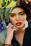 Woman with creative make up, many shawls on head like cubian woman Stock Photos