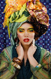 Woman with creative make up, many shawls on head like cubian woman Royalty Free Stock Photo