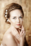 Woman with creative make-up of pearls Stock Photos